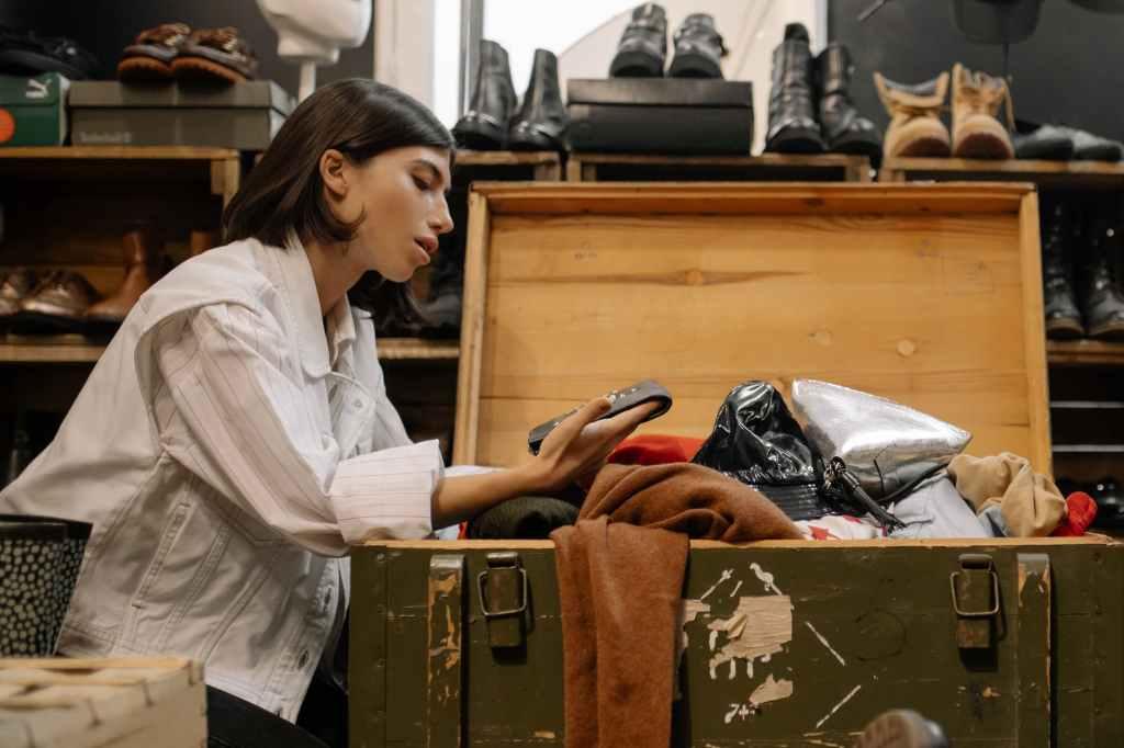 woman looking through a bargain bin
